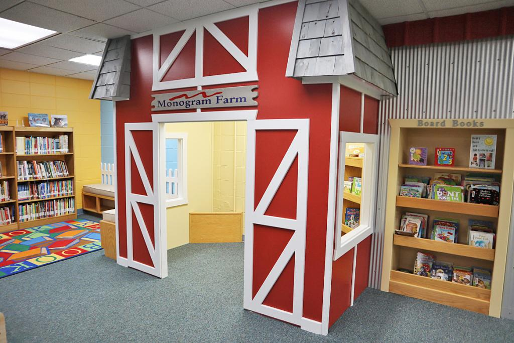 The new Monogram Farm children's play area is pictured at the Harlan Community Library Wednesday, May 26.