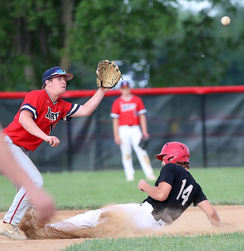 Alex Monson (14) steals second base.