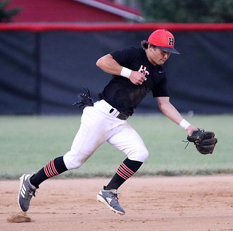 HCHS shortstop Joey Moser fields a ball on the run during Thursday night's home loss to Kuemper Catholic. (Photos by Mike Oeffner)