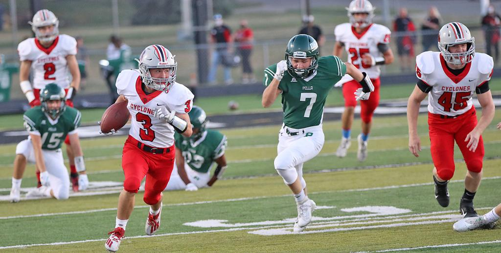 HCHS junior Joey Moser (3) eludes Pella's Quinn Rhamy (7) on a first-half kickoff return. Moser returned three kickoffs for 102 yards. Also pictured for the Cyclones are Connor Frame (2), Zane Bendorf (45) and Brenden Bartley (25).