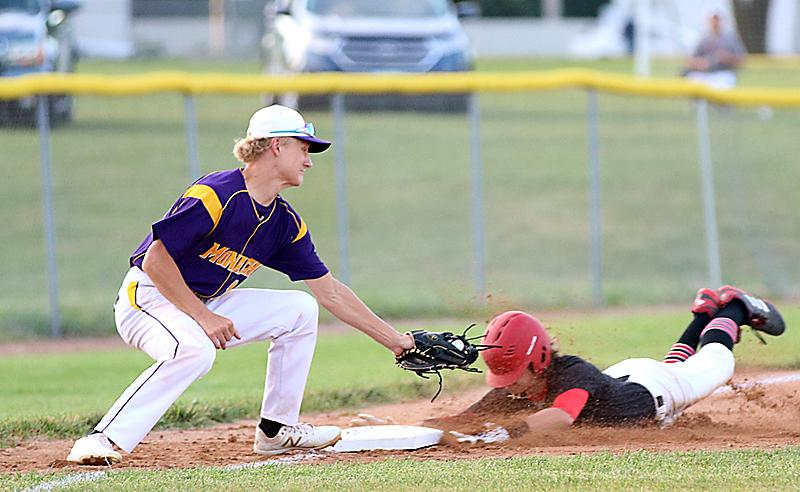 Luke Musich steals third base for the Cyclones.