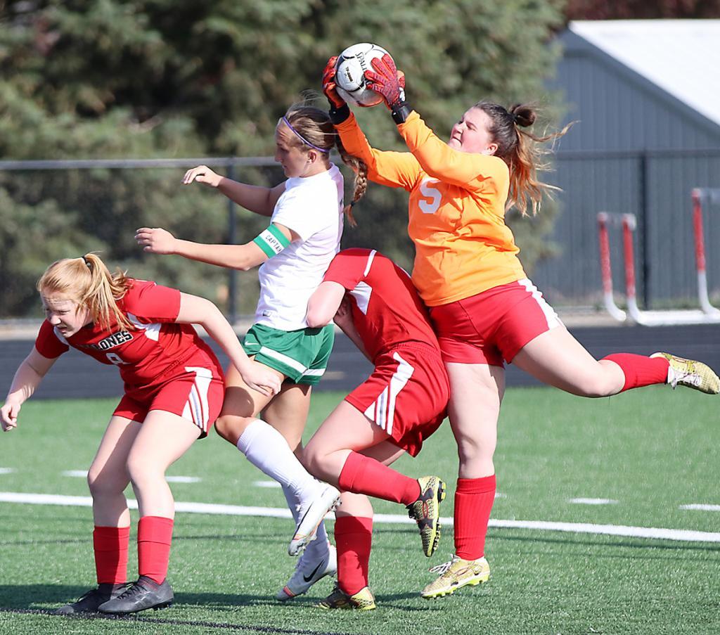 HCHS goalie Lexi Musich (5) makes a save before St. Albert's Teagan Blackburn can put her head on the ball.
