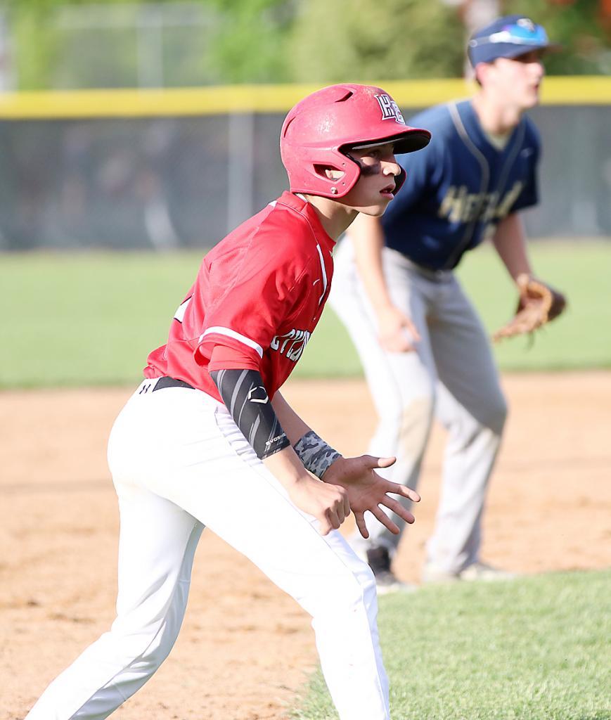 HCHS freshman Lucas Musich leads off third base.