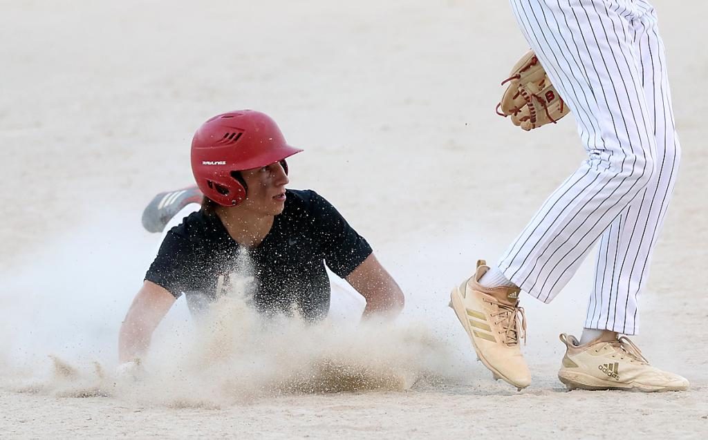 HCHS junior Luke Musich is safe at third with one of the Cyclones' six stolen bases against St. Albert. (Photos by Mike Oeffner)