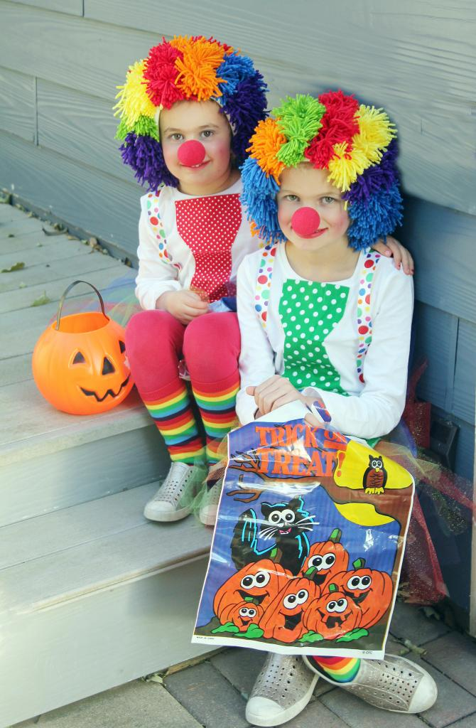 The Ranney sisters, Jamiee, 5, (left) and Hallie, 7, are ready to go trick or treating. They are the daughters of Richard and Keri Ranney, Harlan.  (Photo by Kim Wegener)