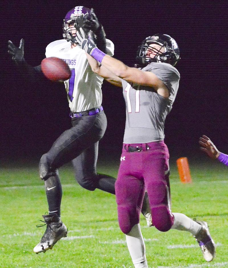 Spartan senior Ian Leader (17) breaks up a pass intended for Stanton's Thomas Bates.