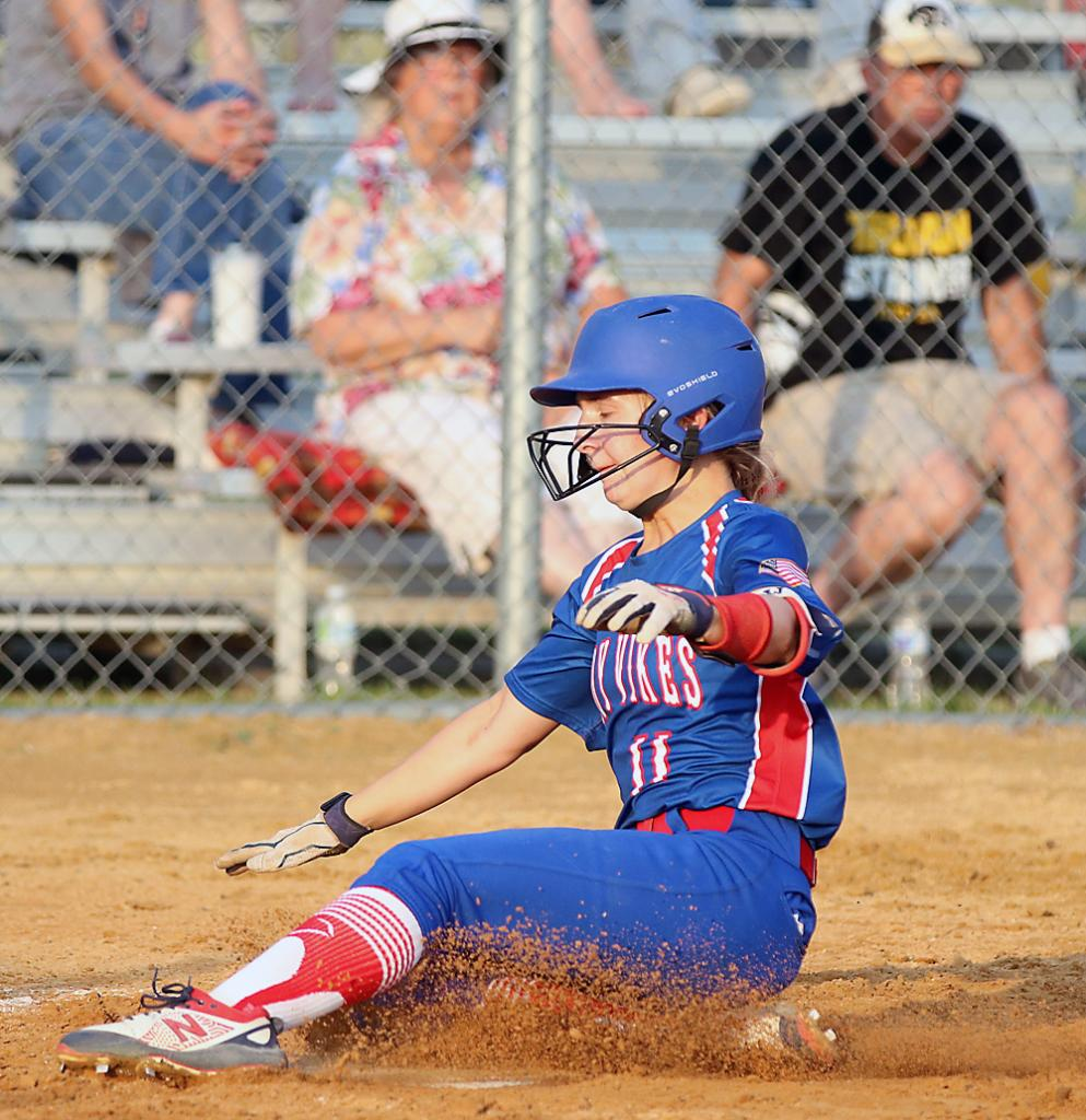 AHSTW freshman Graycen Partlow slides home to score the Lady Vikes' first run of the game against Tri-Center Friday night. (Photos by Mike Oeffner)