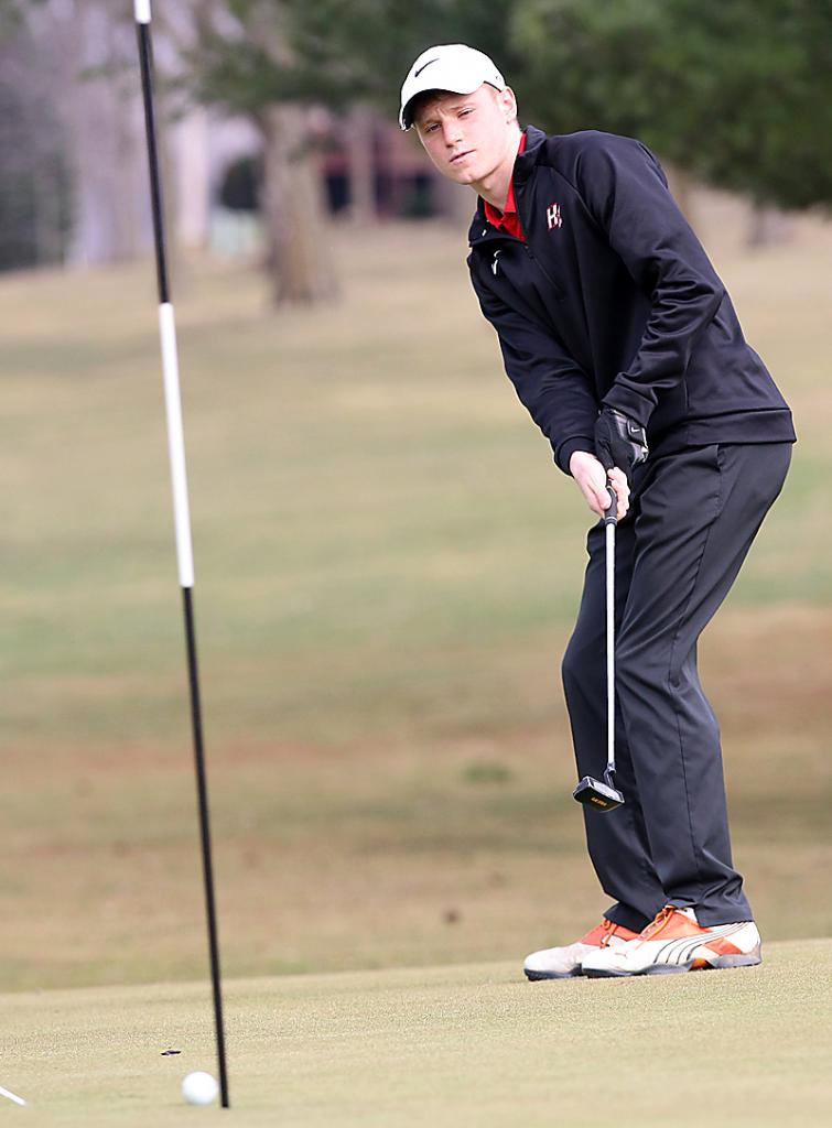 HCHS senior Mason Peters watches his putt slide just past the cup on Friday's first hole.