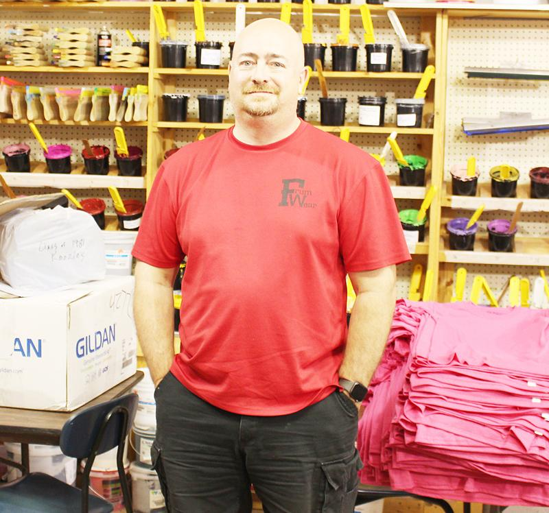 David Frum stands in his printing shop where he does custom t-shirts and memorabilia for the surrounding communities. The FrumWear Custom Screen Printing and Embroidery has been Frum's personal business since 1998 and has been located in southwest Iowa for many years. (Photo by Ryan Pattee)