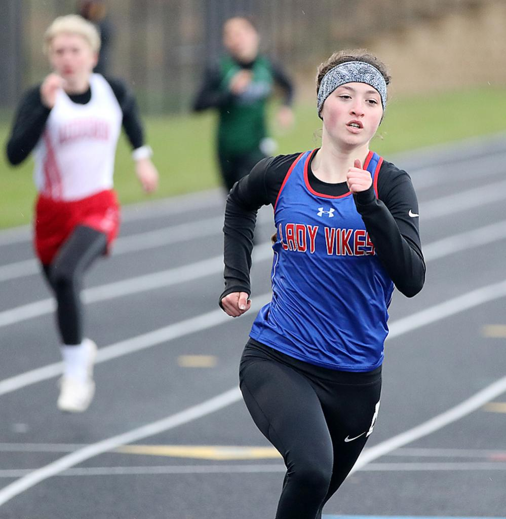 AHSTW junior Ryann Portch heads out of the back stretch during her victory in the 400-meter dash at the Western Iowa Conference Track and Field Championships. Portch also won the 800 and anchored the Lady Vikes' first-place sprint medley relay. (Photos by Mike Oeffner)