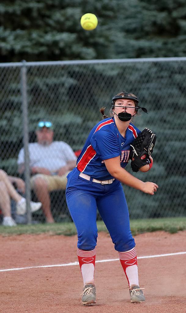 Lady Vike third baseman Grace Porter fires a throw across the diamond.