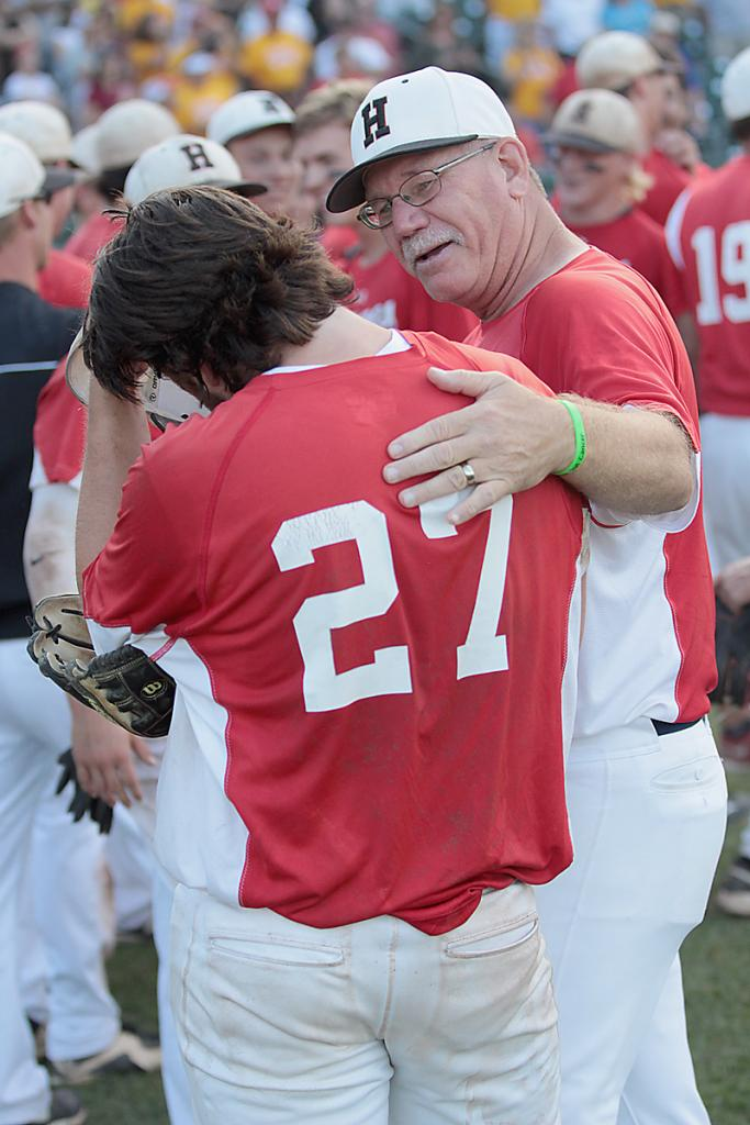 Coach Daeges congratulates winning pitcher Brett Croghan (27) after the Cyclones defeated Carlisle 12-4 to win the 2016 Class 3A state championship.