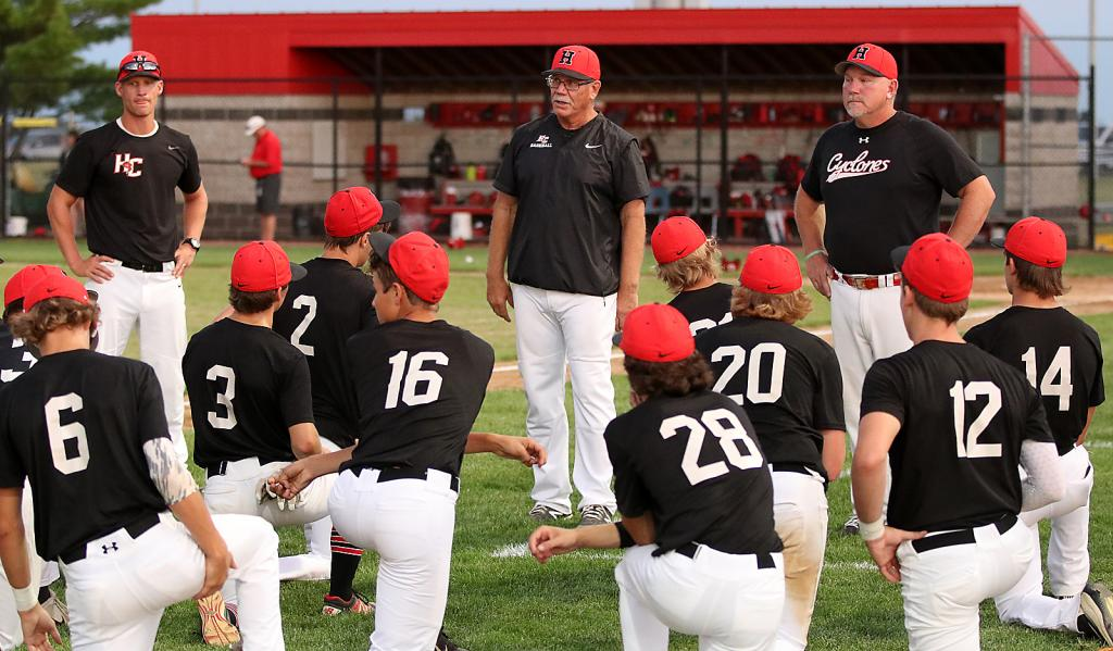 FINAL GAME -- Harlan Community baseball coach Steve Daeges (center) talks to the team following his final game - a 3A substate final loss at Dallas Center-Grimes - on July 22, 2020. Daeges retired as the Cyclone head coach last Tuesday. (Photos by Mike Oeffner)