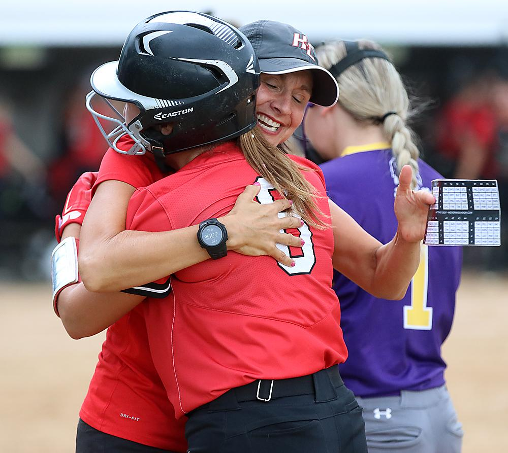 Cyclone assistant coach Ann Heithoff hugs her daughter, Kate, following the team's dramatic 4-3 regional semifinal win over Denison. (Photos by Mike Oeffner)