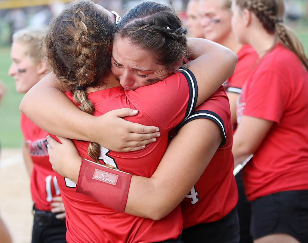 HCHS seniors Madison Schumacher (left) and Emily Brouse hug after the game.