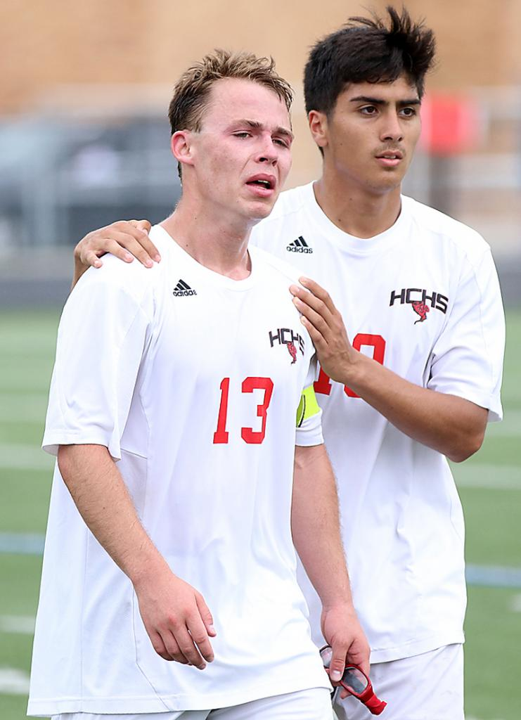 HCHS senior Josh Felix (right) consoles teammate Levi Culp after the loss to LC.