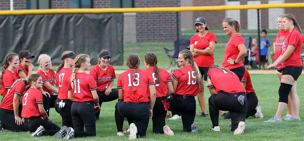 Harlan Community players and coaches chat following Tuesday's regional final loss.