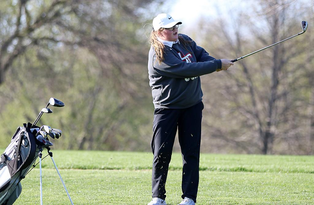 HCHS junior Kayla Powers watches her approach shot on the eighth hole at the Harlan Golf and Country Club Thursday. Powers shot a 53 as the Cyclones placed second in a triangular vs. Clarinda and Denison-Schleswig.