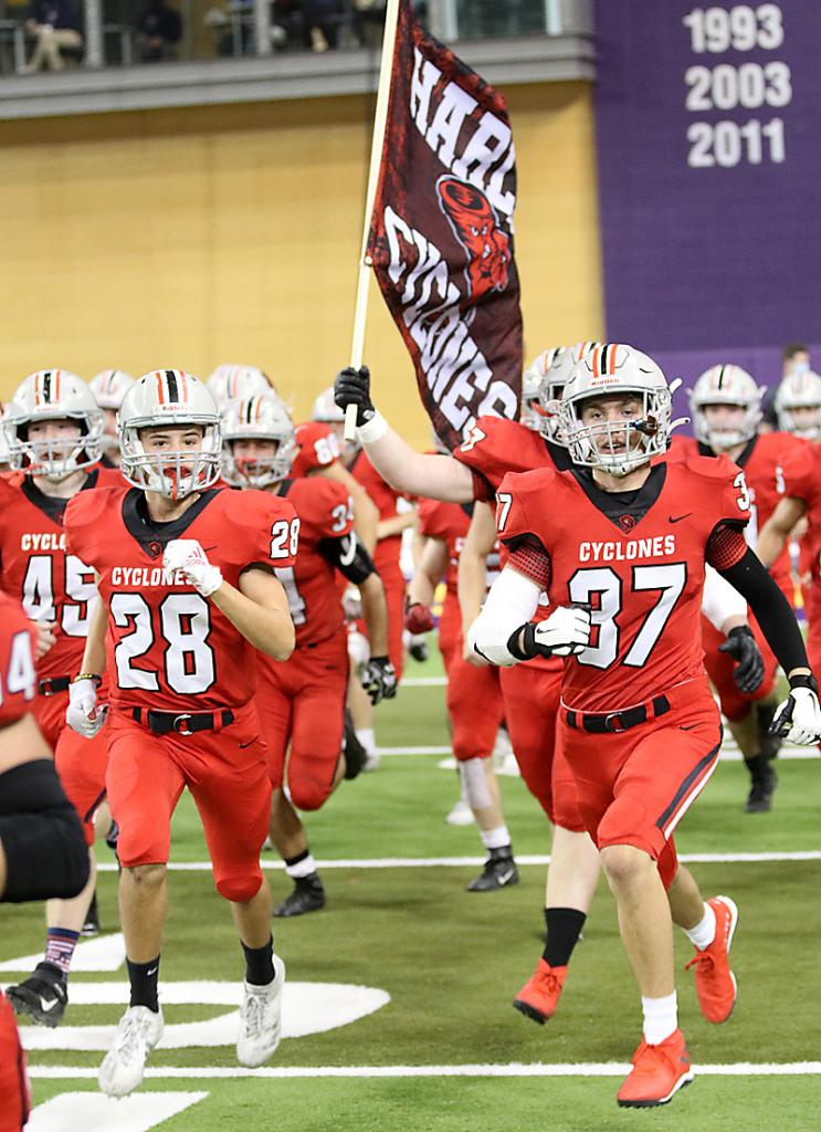Senior Reece Schwery (right) and the rest of the Cyclones take the field for the championship game.