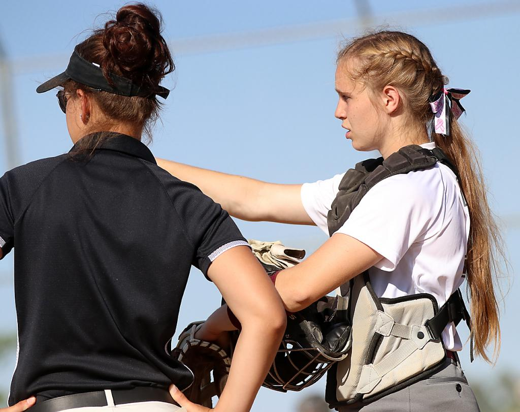 Spartan catcher Quinn Grubbs talks with head coach Andy Nulle between innings.