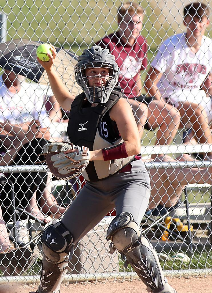Spartan catcher Quinn Grubbs throws to first to finish off a strikeout on a third strike in the dirt.