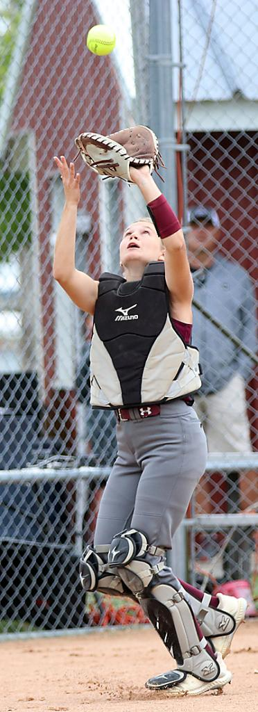 Exira-EHK catcher Quinn Grubbs waits underneath a foul pop-up before making the catch. (Photos by Mike Oeffner)