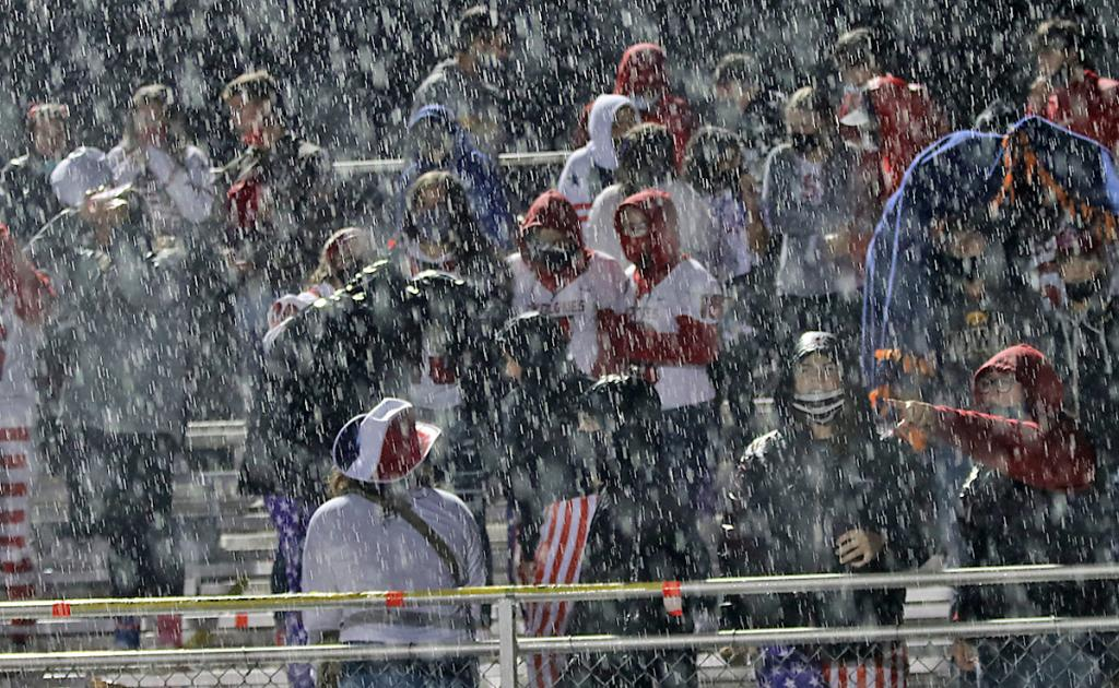 The HCHS student section is doused by some big, fat rain during the fourth quarter.