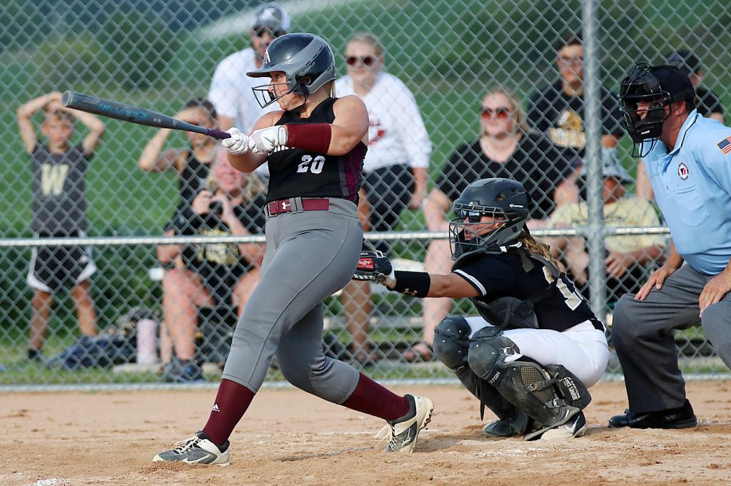 Mollie Rasmussen connects for the game-winning hit to right-center field.