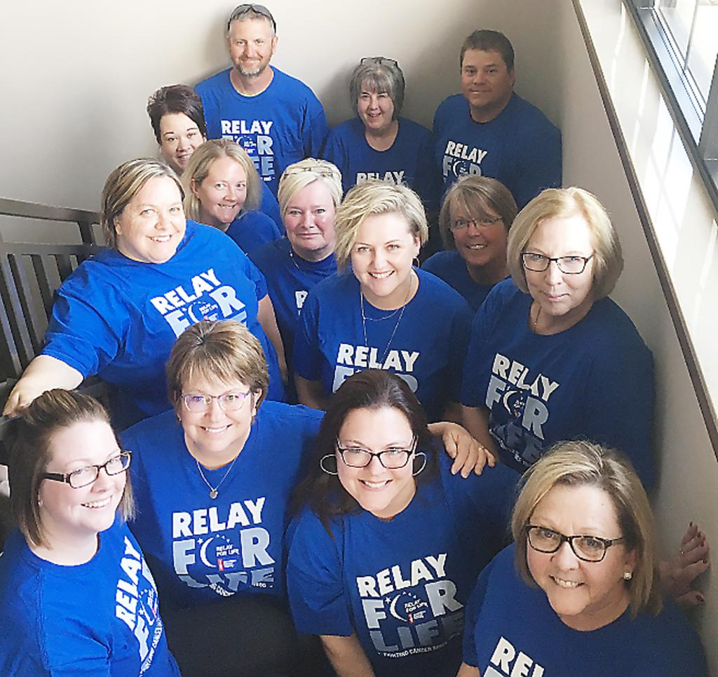 The Shelby Country Relay for Life team gathered recently in Harlan to discuss the event being held at Merrill Field. Front Row: Tara Kelly, Cindy Lefeber, Julie Ziola and  Shelli Larson. Second Row: Dawn Vanden Berg, Renee Hansen and Joan Potter.  Third Row: Jackie Neumann, Joan Bieker and Cindy Schechinger.  Back Row: Emily Barrett, Randy Mages, Denise Wiig and Ray Porter.  Missing were Nancy Kloewer, Paulette Rasmussen, Connie Lehan, Lesly Christensen, Ryan and Mallory Meyer and Josh Hansen.
