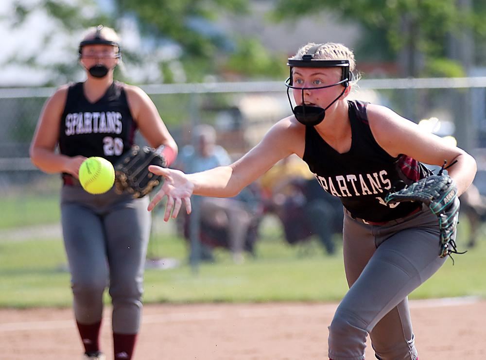 Spartan second baseman Makenzie Riley shovels the ball to first for an out.