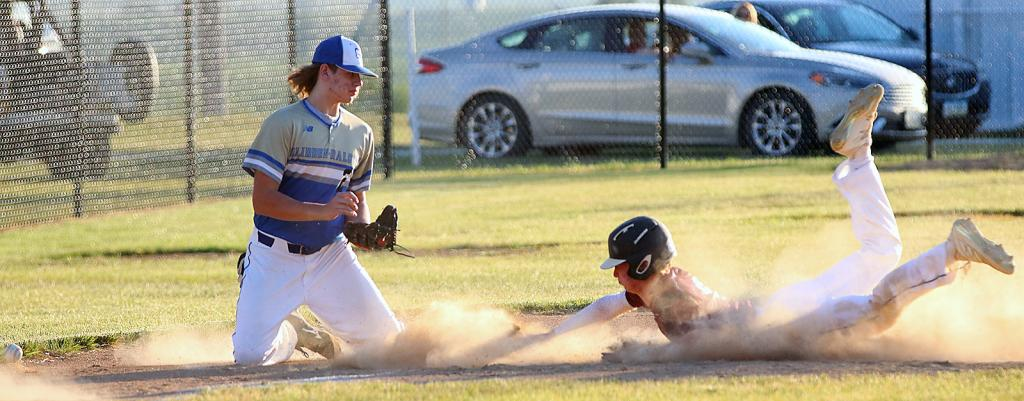 Exira-EHK's Dane Paulsen slides head-first into third base as Glidden-Ralston's third baseman is unable to come up with a low throw during Monday's Rolling Valley Conference game. (Photos by Mike Oeffner)