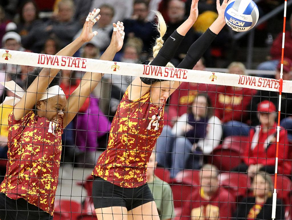 Schaben (14) blocks a West Virginia attack with help from fellow senior Grace Lazard.