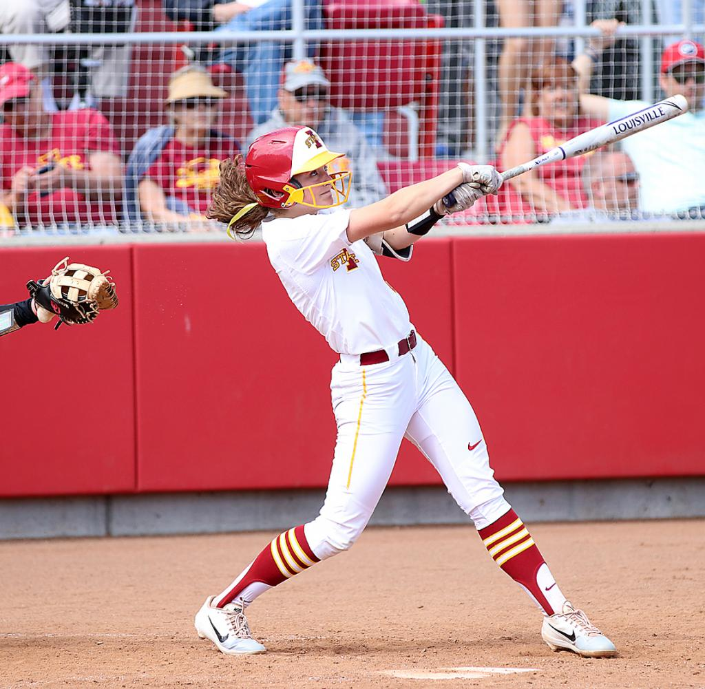 Iowa State University junior Logan Schaben watches a fly ball leave her bat during the Cyclones' home doubleheader vs. top-ranked Oklahoma on April 26. Schaben batted .220 for the Cyclones in 2019 and started 61 out of 62 games as ISU finished 37-25 overall for its first winning season since 1995. (Photos by Mike Oeffner)