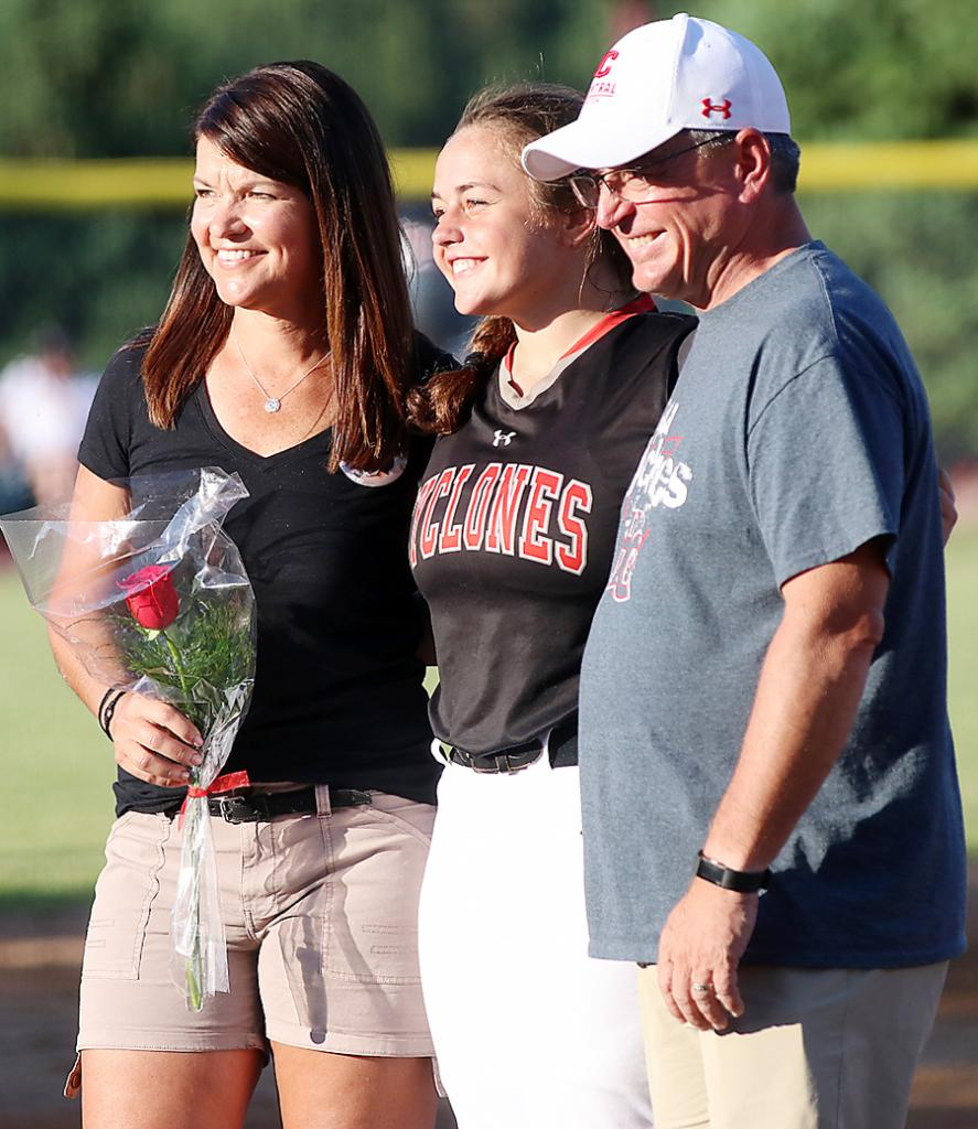 Harlan Community's only softball senior, Morgan Schaben, is recognized prior to the game along with her parents, Gary and Jackie Schaben.