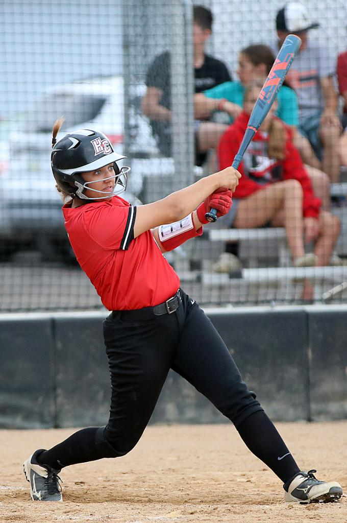 HCHS senior Julia Schechinger hits a sixth-inning single as part of her two-hit night against the Titans.