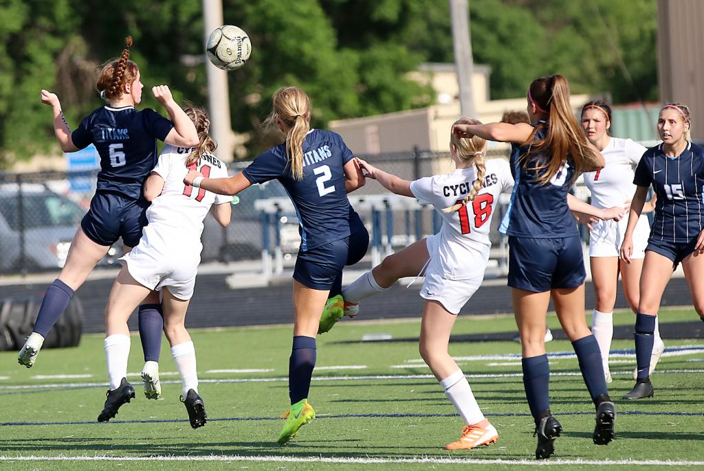 Harlan Community and Lewis Central players scramble for the ball during Wednesday's Class 2A regional semifinal game. Left to right: Haylee Erickson of LC, Ava Miller of HCHS, Haley Bach of LC, Samantha Ineson of HCHS, Hana Daoudi of LC, Ava Monson of HCHS and Hannah Estrada of LC. (Photos by Mike Oeffner)