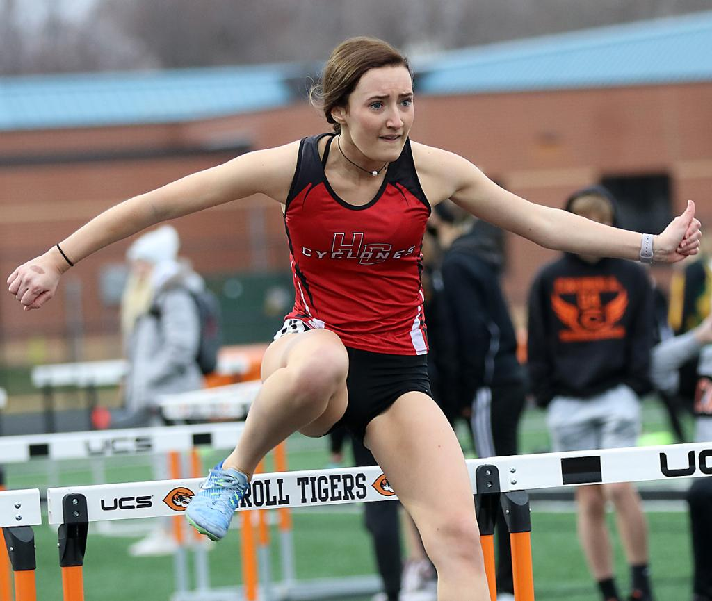 Lucy Metzger anchors the Cyclone girls' first-place shuttle hurdle relay.