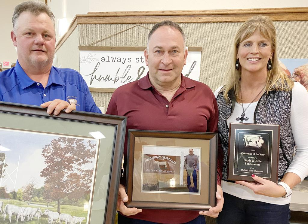 Guyle Sonderman (center), owner, Sonderman Charolais Farm, Portsmouth,  is pictured with his wife, Julie, and Cattlemen's president, Ken Schechinger