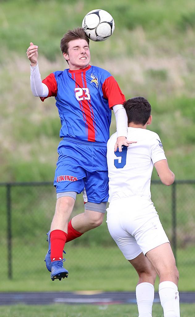 AHSTW's Zach Stanton jumps over Underwood's Blake Schweers to get a head on the ball.
