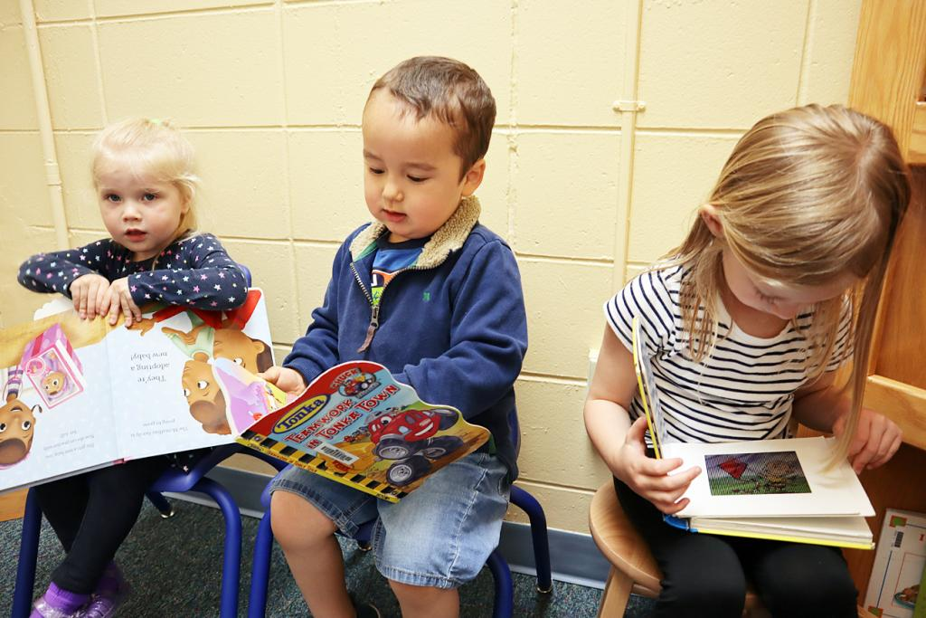 Shown (L to R) - Rosie Staley, Grant Goddard and Charlie Andersen read in the new Monogram Farm children's play area at the Harlan Community Library Wednesday, May 19.  (Photo by Molly Blanco)