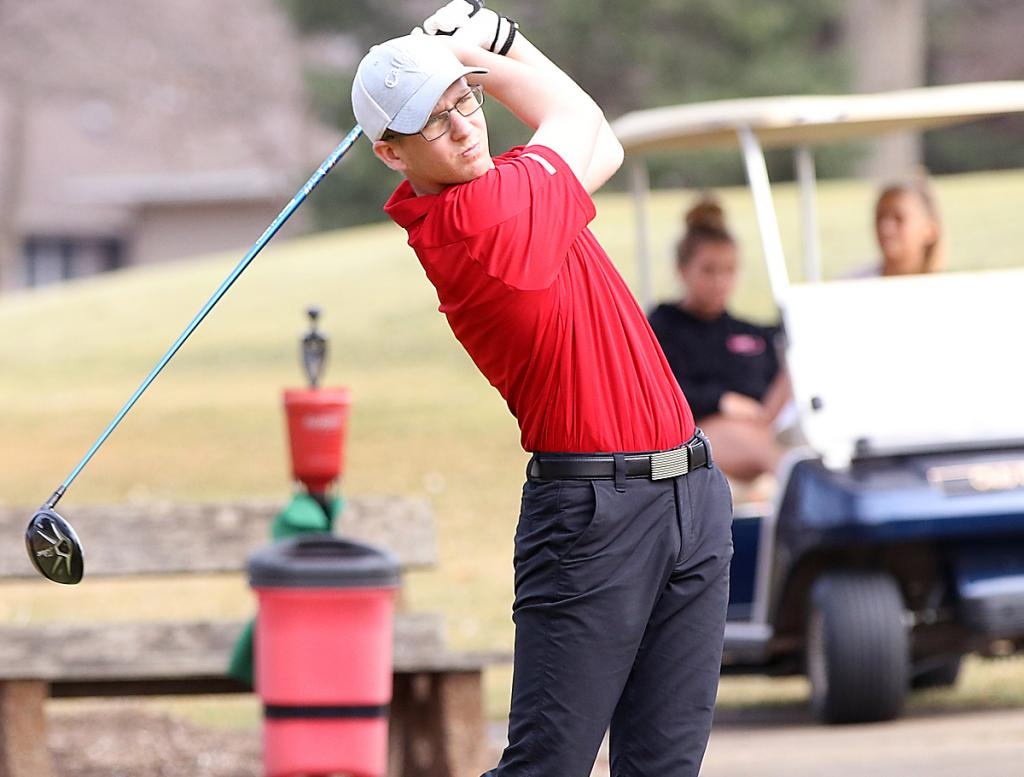 HCHS senior Jay Swanson watches his tee shot on hole number two during Friday's medalist round of 38 against Denison. (Photos by Mike Oeffner)