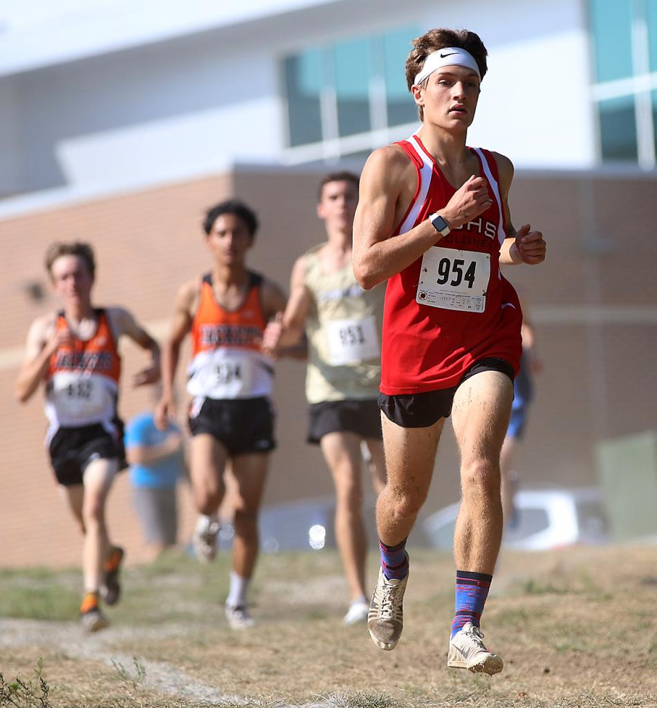 Harlan Community senior Trey Gross leads a pack of runners during the first half of Saturday's Lynx Invite at Iowa Western Community College. Gross placed fourth on the day and HCHS also took fourth as a team.