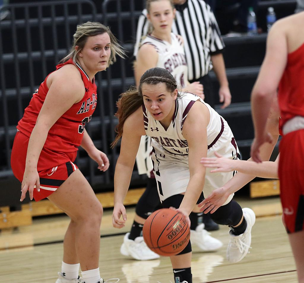 Spartan senior Tatum Grubbs splits the Rocket defense, including Sara Schurke (left). Grubbs finished with a game-high 26 points.