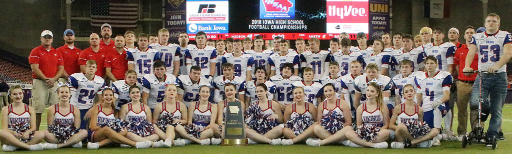 AHSTW football players, coaches and cheerleaders pose for a team photo with the Vikings' Class A state runner-up trophy following Thursday's 30-7 loss to Hudson in the state championship game at the UNI-Dome. AHSTW, appearing in its first title game since 1991, finished the season 12-1 overall. (Photos by Mike Oeffner)