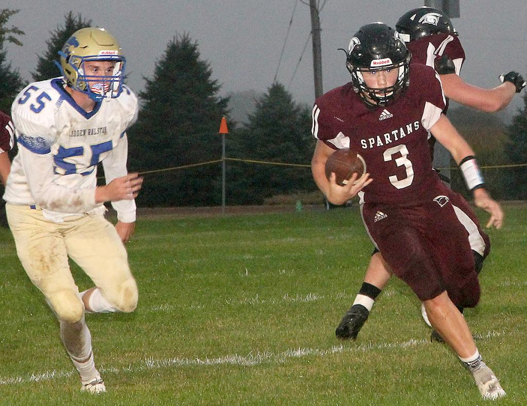 Exira-EHK quarterback Trey Petersen (3) gains some yardage during Friday's first half against Glidden-Ralston. (Photo by Kim Wegener)
