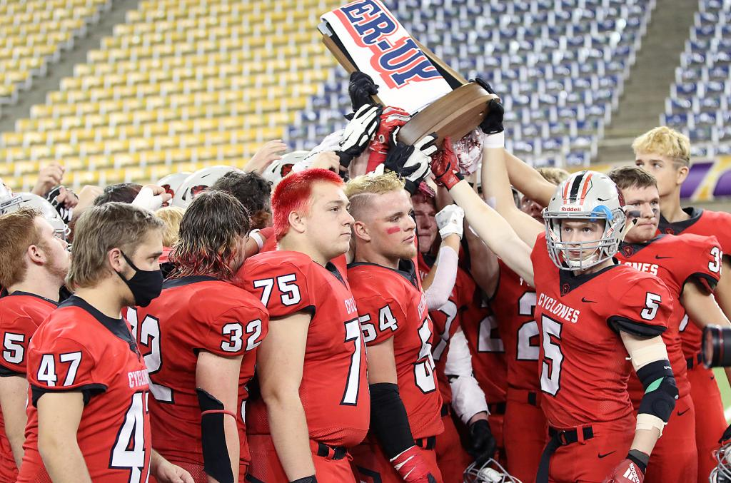HCHS players hold up their Class 3A state runner-up trophy following Thursday's loss to North Scott.