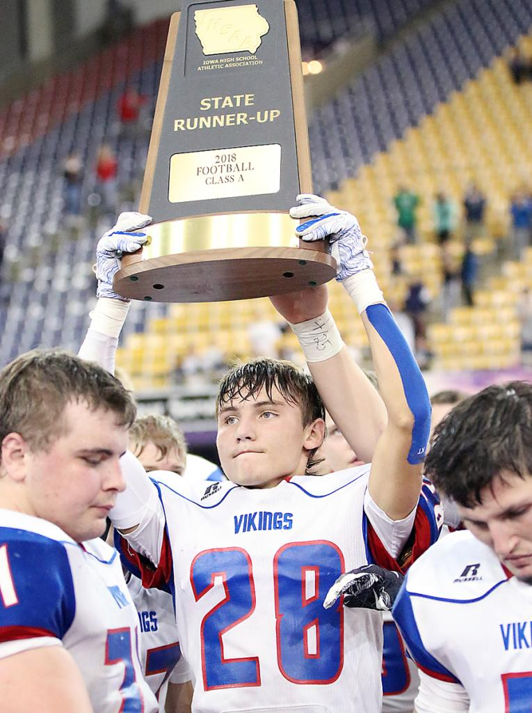 AHSTW senior Drake Partridge holds up the Vikings' Class A state runner-up trophy. Also pictured are Viking junior Brady Canada (left) and senior Brayton Tuma.