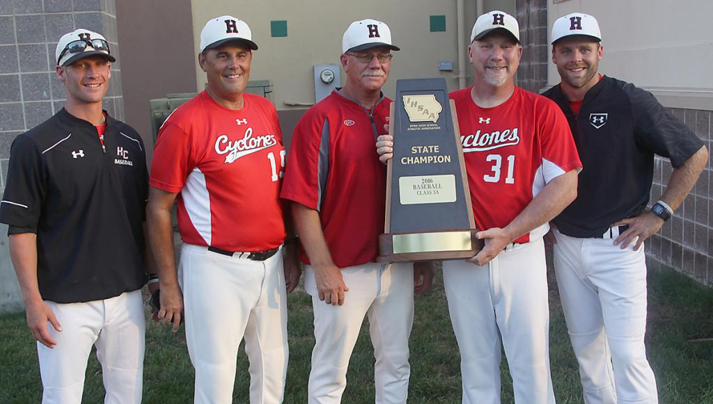Left-right: Heath Stein, Mark Vande Berg, Steve Daeges, Joe Heese and Eric Croghan show off the school's 2016 championship trophy. Daeges was also the head coach for Cyclone title winners in 1996 and 2003.