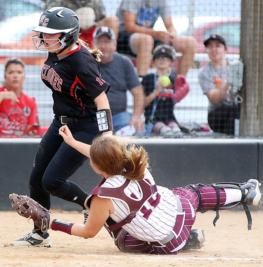 Cyclone courtesy runner Tyann Viereck knocks over Fillies' catcher Macee Blank while scoring a run during the third inning of game one. HCHS won 5-0 and 5-2 and took over first place in the Hawkeye Ten. (Photos by Mike Oeffner)