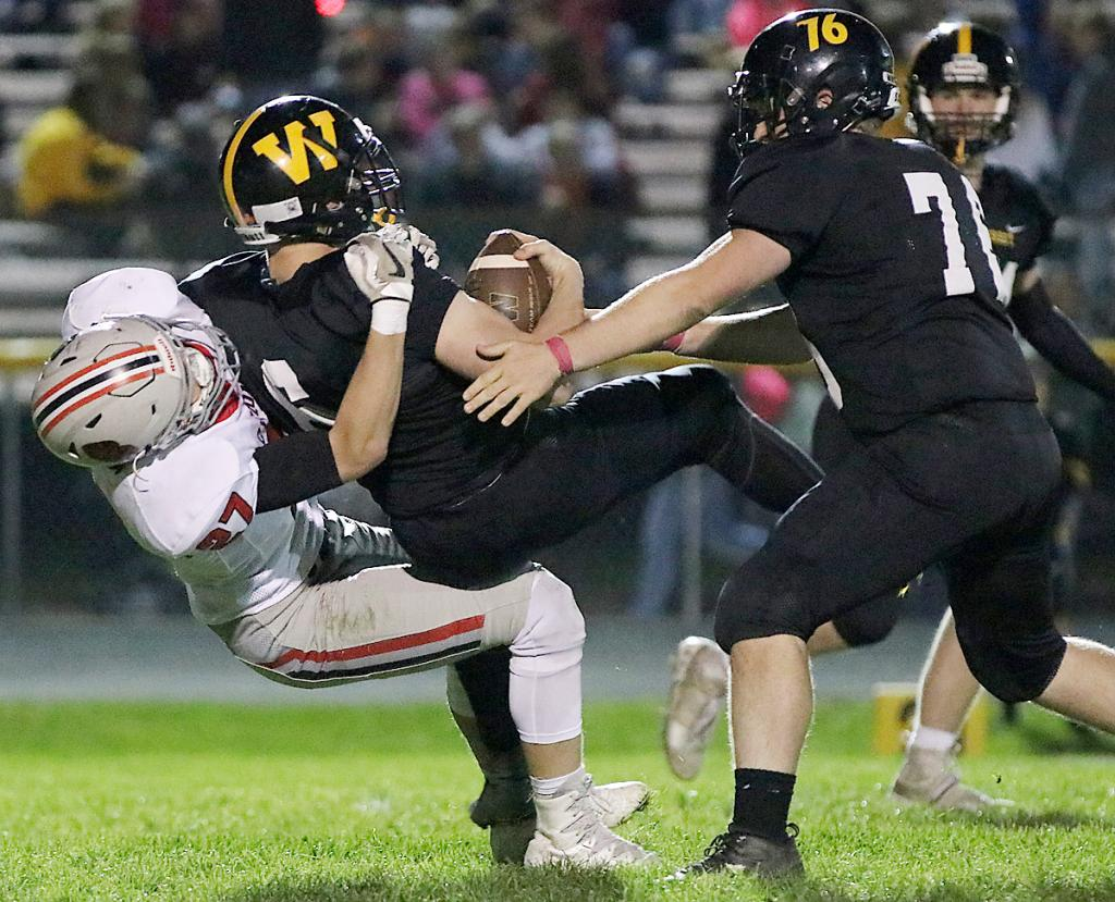 Cyclone linebacker Wyatt Schaben (left) tackles Winterset's Hunter Pashek last Friday. Schaben leads HCHS with 64 tackles.